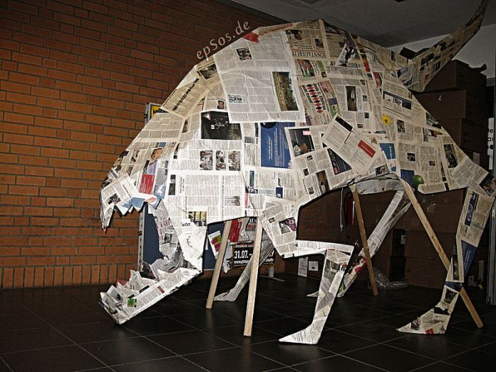 Scary picture prank of a big dog monster in form of an origami dragon. Author epSos.de