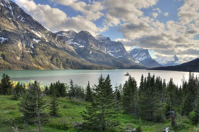 Wild Goose Island, a narrow, 300-foot-tall spire surviving in the middle of a lake carved by a glacier, is the most photographed spot in all of Glacier National Park. Author Jeremy Bronson